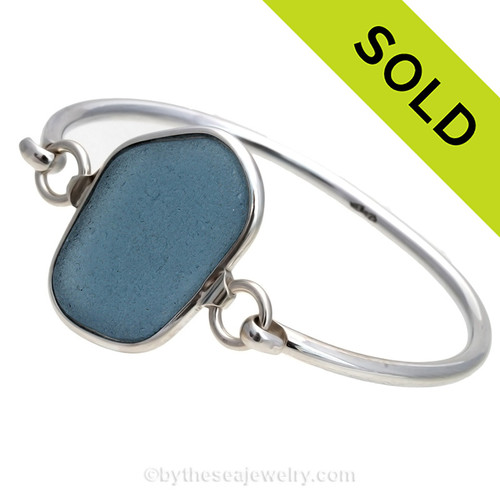 Genuine Squarish Gray Blue Sea Glass Bangle Bracelet set in our Deluxe Wire Bezel© sterling silver setting. Sorry this piece of Sea Glass Jewelry has been sold!