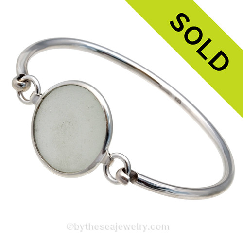 Genuine Sea Glass Bottle Stopper Top Bangle Bracelet set in our Deluxe Wire Bezel© sterling silver setting. Sorry this Sea Glass Bracelet has been SOLD!