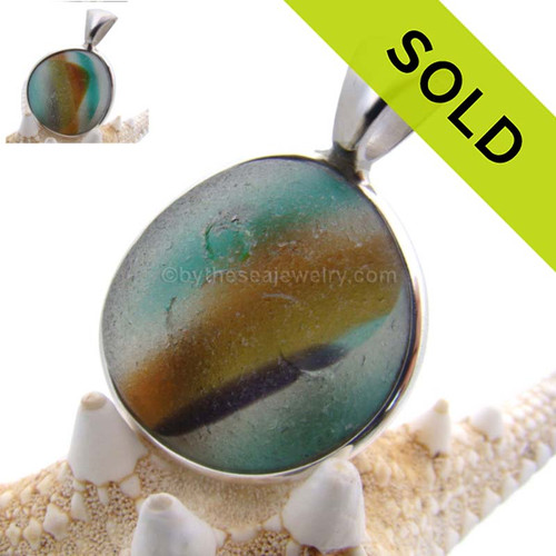 This ultra rare Seaham sea glass multi color pendant is set in our Deluxe Wire Bezel© pendant setting. Classic and elegant, a timeless treasure! Sorry this Ultra Rare Sea Glass Pendant is no longer available.