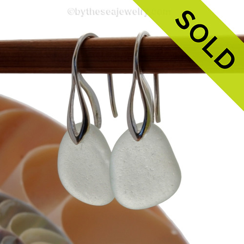 A pair of natural surf tumble sea glass earrings in a pure white on sterling deco hooks. SOLD - Sorry these Sea Glass Earrings are NO LONGER AVAILABLE!
