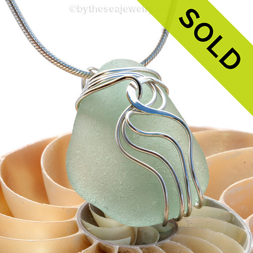 A beautiful natural seafoam sea glass jewelry set in our original signature waves setting in solid sterling silver. Sorry this Sea Glass Necklace pendant has been SOLD!