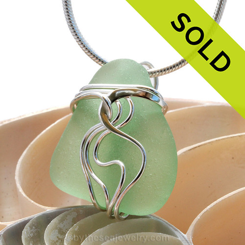 "A beautiful natural yellowy seafoam sea glass jewelry set in our original signature ""Waves"" setting in solid sterling silver.  Sorry this Sea Glass Necklace pendant has been SOLD!"