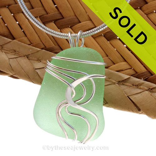 "A beautiful natural yellowy seafoam squarish sea glass pendant set in our original signature ""Waves"" setting in solid sterling silver. Sorry this Sea Glass Jewelry selection is NO LONGER AVAILABLE!"