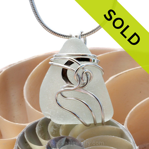 """A beautiful pure white sea glass pendant set in our original signature """"Squiggles"""" setting in solid sterling silver. Sorry this Sea Glass Jewelry piece has been sold!"""