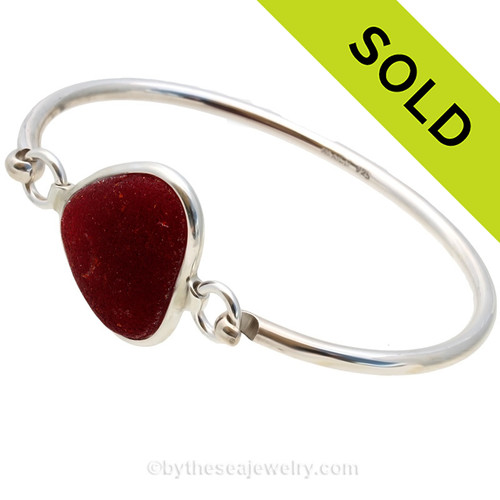 Genuine Sea Glass Bangle Bracelet in a P-E-R-F-E-C-T Ruby Red set in our Deluxe Wire Bezel© sterling silver setting. SOLD - Sorry this Sea Glass Jewelry selection is NO LONGER AVAILABLE!