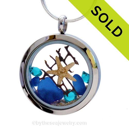 Beautiful pieces of natural Cobalt Blue sea glass combined in a stainless steel locket necklace with a real starfish, a bit of vintage seafam & Zircon crystal Gems. Sorry this Sea Glass Jewelry selection has been SOLD!
