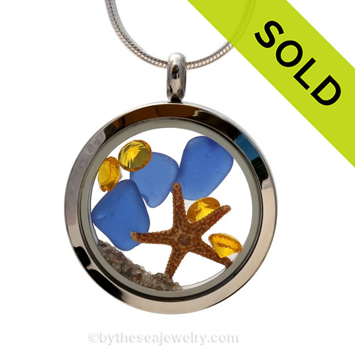A great locket for anyone, specially those with an November birthday. Genuine cobalt blue sea glass combined  Brightened up with genuine Topaz crystal gems (November Birthstone).