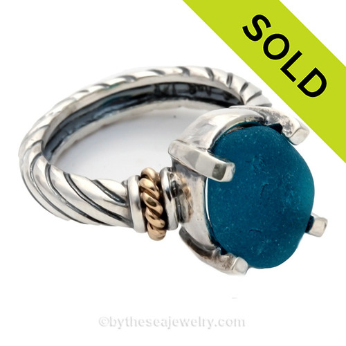 An Ultra Rare rare piece of Bright Electric Teal Blue Genuine Sea Glass Ring in a Sterling setting highlighted with 14k gold accents. Sorry this Sea Glass Jewelry piece has been SOLD!