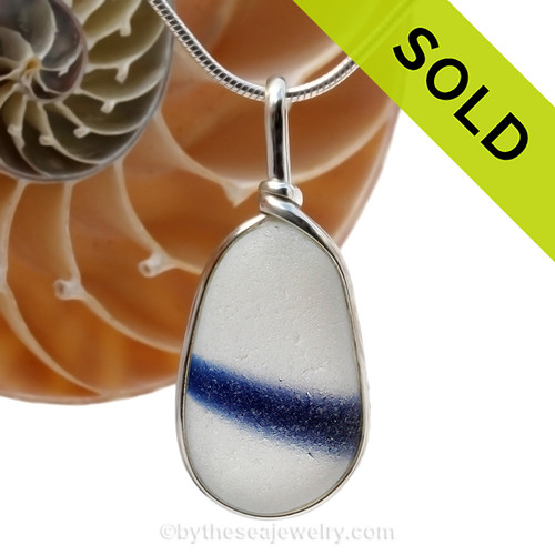 A beautiful very large piece of vivid blue and white mixed sea glass set for a necklace in our Original Sea Glass Bezel© in solid sterling silver setting. Sorry this Ultra Rare Sea Glass Pendant is NO LONGER AVAILABLE!