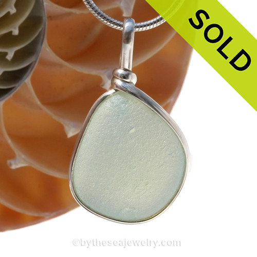 SOLD - Sorry This Sea Glass Jewelry Selection Is NO LONGER AVAILABLE! A stunning piece opalized sea glass set in our Original Wire Bezel© pendant setting. This picture does not do the piece justice. In natural light, this piece will really GLOW a pale yellow and luminous pink and bluish glow.
