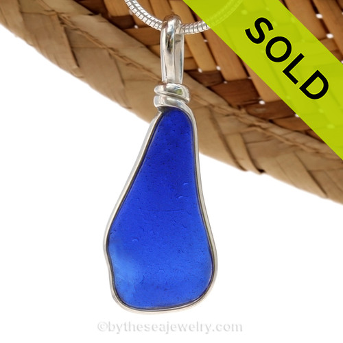 An irregular but thicker piece of Cobalt Blue Genuine Sea Glass with in our signature Original Wire Bezel© pendant setting in Sterling Silver. SOLD - Sorry this Sea Glass Jewelry Selection is NO LONGER AVAILABLE!