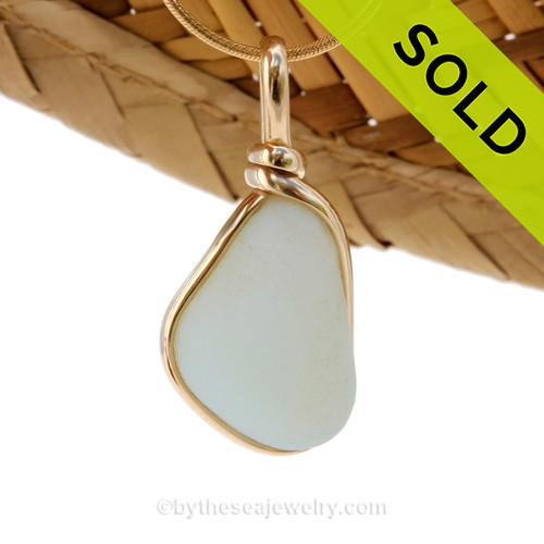 A stunning piece opalized sea glass set in our Original Wire Bezel© pendant setting in gold.  SOLD - Sorry this Ultra Rare Sea Glass Pendant is NO LONGER AVAILABLE!