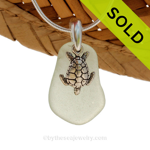 Beach found smaller seafoam green sea glass is combined with a solid sterling sea turtle charm and presented on an 18 Inch solid sterling snake chain. Sorry this Sea Glass Necklace has been sold!