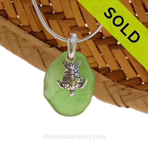 A perfect piece of olive or jungle green sea glass is combined with a solid sterling sea turtle and presented on an 18 Inch solid sterling snake necklace chain. Sorry this Sea Glass Necklace has been SOLD!
