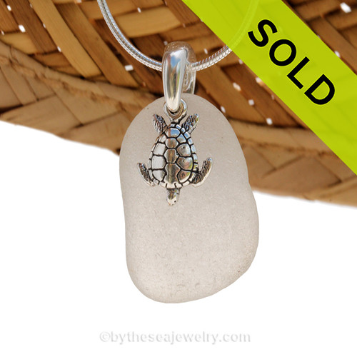 A perfect piece of pure white sea glass is combined with a solid sterling sea turtle and presented on an 18 Inch solid sterling snake necklace chain. Sorry this Sea Glass Jewelry selection has been SOLD!