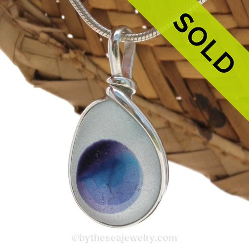 These mixed sea glass pieces are the remnants of art glass scraps being discarded into the North Sea. Beautiful and unusual sea glass set in our Original Wire Bezel© necklace pendant setting. Sorry this Sea Glass Jewelry item has been SOLD!