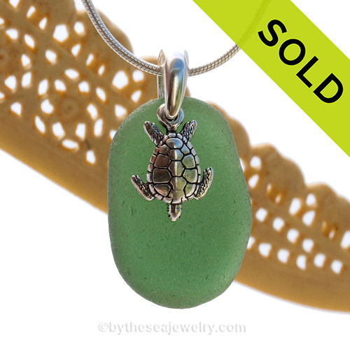 A perfect piece of deeper green sea glass is combined with a solid sterling sea turtle and presented on an 18 Inch solid sterling snake necklace chain. Sorry this Sea Glass Necklace has been SOLD!