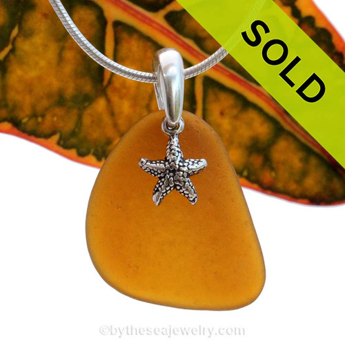 A perfect piece of natural beach found amber brown sea glass is combined with a solid starfish charm and presented on an 18 Inch solid sterling snake chain. Sorry this Sea Glass Jewelry selection has been SOLD!