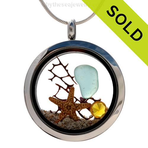 ropical Aqua sea glass combined with a real starfish and bit of vintage seafan and brightened up with a genuine Topaz crystal gems (November Birthstone). Sorry this Sea Glass Jewelry piece has been SOLD!