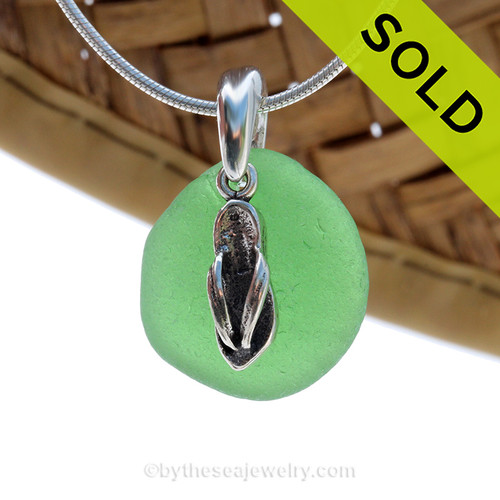Seafoam Green sea glass set on a solid sterling cast bail with a sterling silver Flip Flop charm. Sorry this sea glass necklace has been SOLD.
