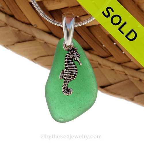 Vivid Green sea glass set on a solid sterling cast bail with a sterling silver seahorse charm. Sorry this Sea Glass Necklace has been SOLD!