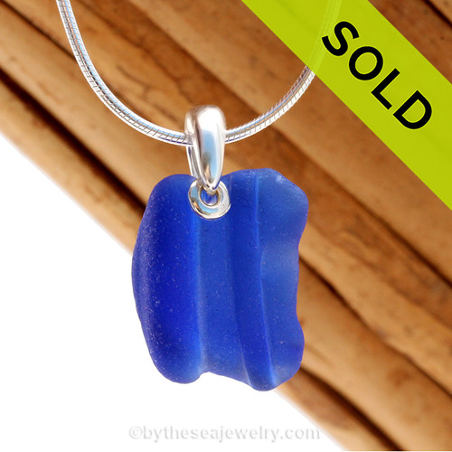 A neat  piece of ridged blue sea glass is combined on a solid sterling cast bail and presented on an 18 Inch solid sterling snake necklace chain. Sorry this Sea Glass Necklace has been SOLD!