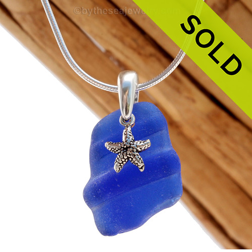 A neat  piece of ridged blue sea glass and starfish charm on a solid sterling cast bail and presented on an 18 Inch solid sterling snake necklace chain. Sorry this Sea Glass Necklace has been SOLD!
