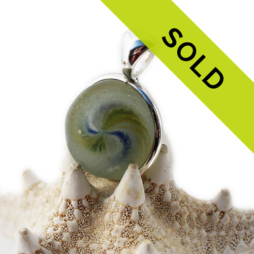 This onionskin beach found marble pendant has sold