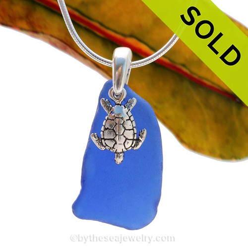 A larger piece of Cobalt Blue Certified Genuine Sea Glass in a Sterling Necklace with a Sea Turtle Charm. Sorry this Sea Glass Jewelry selection has been SOLD!