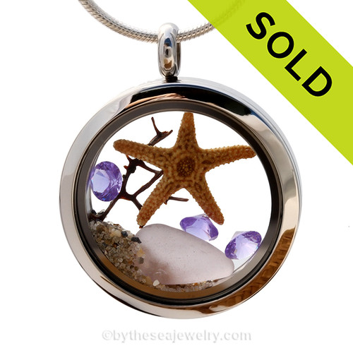 Stunning early 20th century purple or lavender sea glass combined with beach sand, a bit of sea fan and brightened up with amethyst gems makes this a great choice for a February Birthday. Sorry this Sea Glass Jewelry selection has been SOLD!