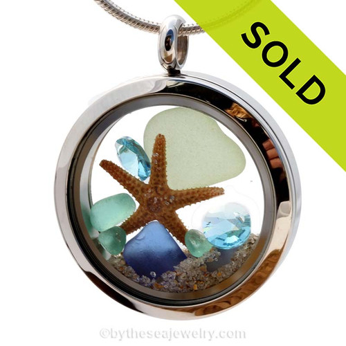 Beautiful pieces of natural Cobalt Blue, Seafoam and Aqua sea glass combined in a stainless steel locket necklace with a real starfish & Zircon & Turquoise crystal Gems. Sorry this Sea Glass Jewelry selection has been SOLD!