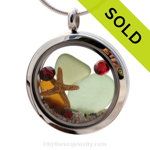 Green and amber sea glass and garnet red gemstones make this a great locket necklace for the holidays or a January Sea Glass Lover! Sorry this Sea Glass Jewelry piece has been SOLD!