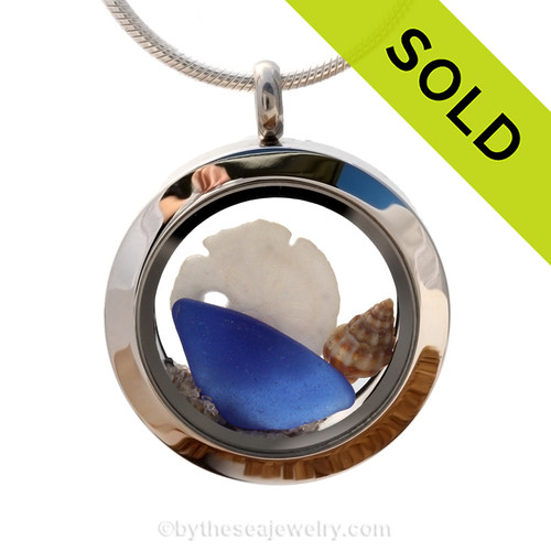 Genuine sea glass in cobalt blue a real baby sandollar in this mini sea glass locket necklace. A tiny sea shell and beach sand make this your own personal Beach-On-The-Go! SOLD - Sorry this Sea Glass Locket is NO LONGER AVAILABLE!