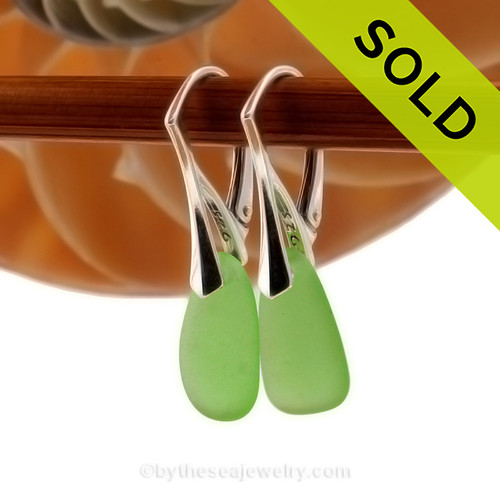 Green bright genuine sea glass pieces shaped only by the sea, sand and time are suspended on solid sterling leverback earrings. SOLD - Sorry these Sea Glass Earrings are NO LONGER AVAILABLE!