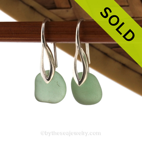 Simple beach found petite green sea glass earrings on solid sterling silver deco hooks. Sorry these Sea Glass Earrings have been sold!