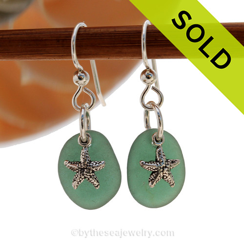 Natural medium rare teal green sea glass pieces are set with solid sterling  starfish charms and are presented on sterling silver fishook earrings. SOLD - Sorry This Sea Glass Jewerly Selection Is NO LONGER AVAILABLE!