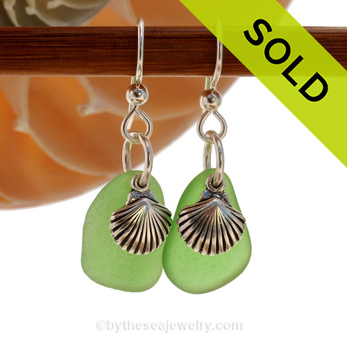 Natural beach found green sea glass pieces are set with solid sterling sea shell charms and are presented on sterling silver fishook earrings. SOLD - Sorry these Sea Glass Earrings are NO LONGER AVAILABLE!
