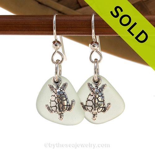 A perfect matched pair of beautiful very pale green sea glass earrings combined with solid sterling Sea Turtle charms. Sorry this Sea Glass Jewelry selection has been SOLD!
