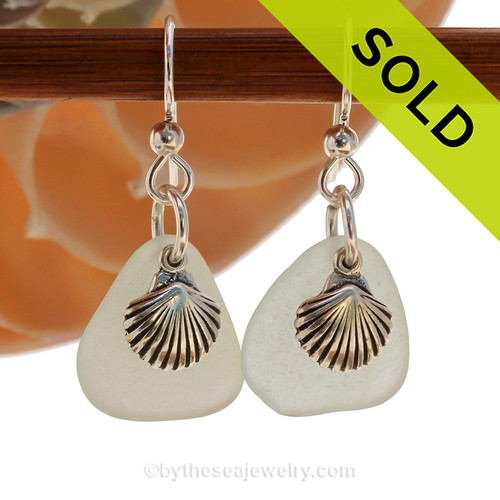 A perfect matched pair of beautiful very pale green sea glass earrings combined with solid sterling Sea Shell charms.  SOLD - Sorry these Sea Glass Earrings are NO LONGER AVAILABLE!