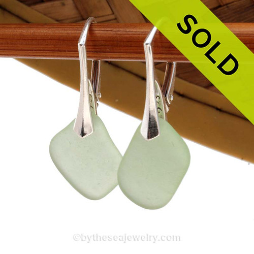 Simple beach found green sea glass earrings on solid sterling silver leverbacks. Sorry these Sea Glass Earrings have been SOLD!