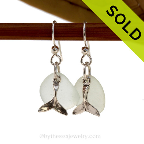 A perfect matched pair of beautiful very pale green sea glass earrings combined with solid sterling Whale Tail charms. SOLD - Sorry these Sea Glass Earrings are NO LONGER AVAILABLE!