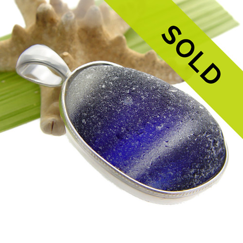 This is a HUGE perfect piece of sea glass from Seaham England set in our Deluxe Wire Bezel© necklace pendant setting. Truly a work of art. Sorry this one of a kind sea glass jewelry piece has been SOLD!