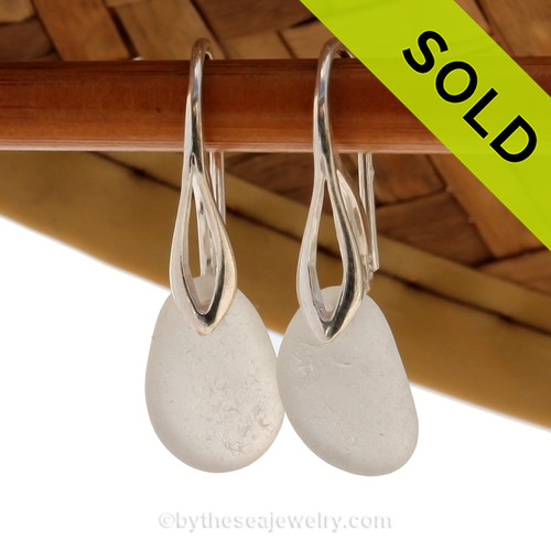 Airy and light pure white sea glass earrings in sterling on solid sterling deco hooks. SOLD - Sorry these Sea Glass Earrings are NO LONGER AVAILABLE!