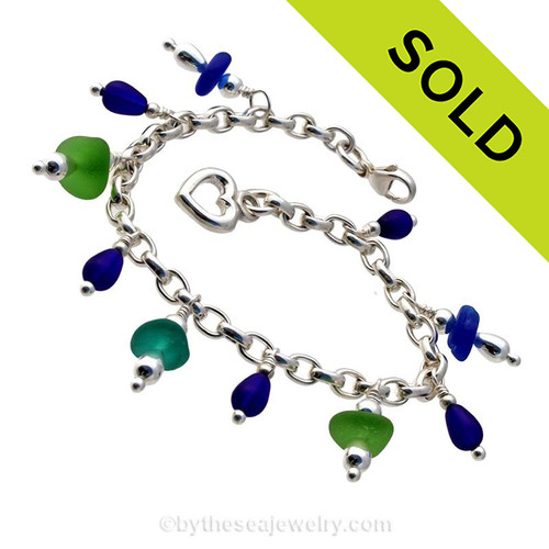 5 pieces of genuine beach found sea glass combined frosted cobalt blue beads in a totally solid sterling silver bracelet and finished with a solid sterling heart charm.