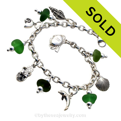 5 pieces of green genuine beach found sea glass combined with solid sterling beach inspired charms in a totally solid sterling silver bracelet. SOLD - Sorry this Sea Glass Charm Bracelet is NO LONGER AVAILABLE!