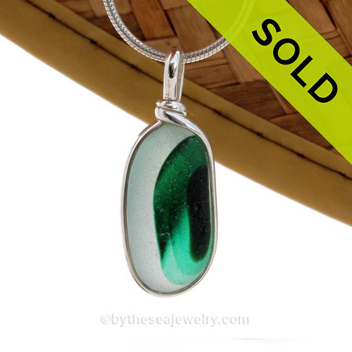 A Vibrant Green Mixed English Multi sea glass set for a necklace in our Original Sea Glass Bezel© in Solid Sterling Silver setting. Originating as end of day art glass tossed into the sea and rolled around for over 100 years