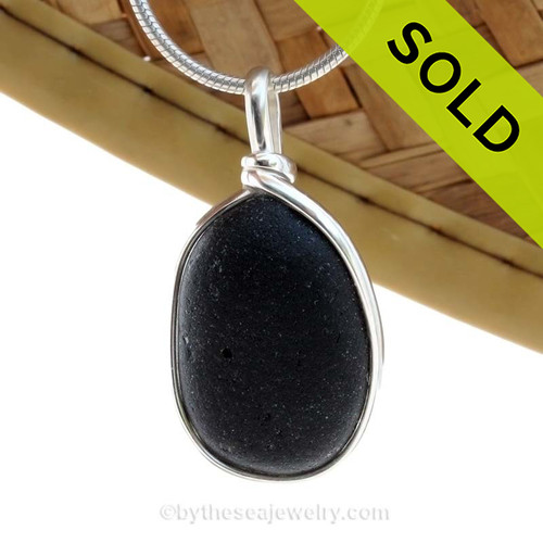 SOLD - Sorry This Sea Glass Jewerly Selection Is NO LONGER AVAILABLE! A deep almost pitch black sea glass is set in our Original Wire Bezel© pendant setting.