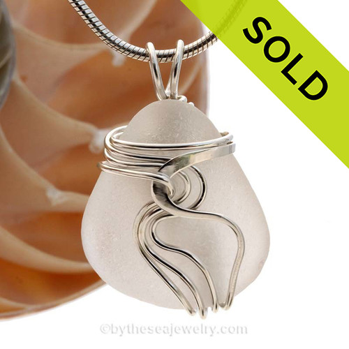 A nice piece of pure white natural sea glass in our WAVES sterling pendant setting that maximizes the bling of silver yet leaves most of the sea glass open and UNALTERED from the way it was collected on the beach. Sorry this sea glass jewelry piece has been SOLD!