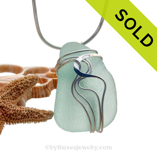 "A beautiful natural pale aqua green sea glass pendant set in our original signature ""Waves"" setting in solid sterling silver. Sorry this Sea Glass Jewelry piece has been SOLD!"