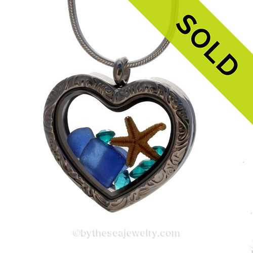 Cobalt Blue sea glass combined a large silver heart locket necklace. Sorry this sea glass jewelry piece has been SOLD!